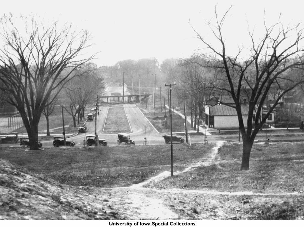 Looking west along Iowa Avenue from the hill in front of the Old Capitol. Block 98 is located on the right. Photograph ca. 1910s from the University of Iowa libraries.