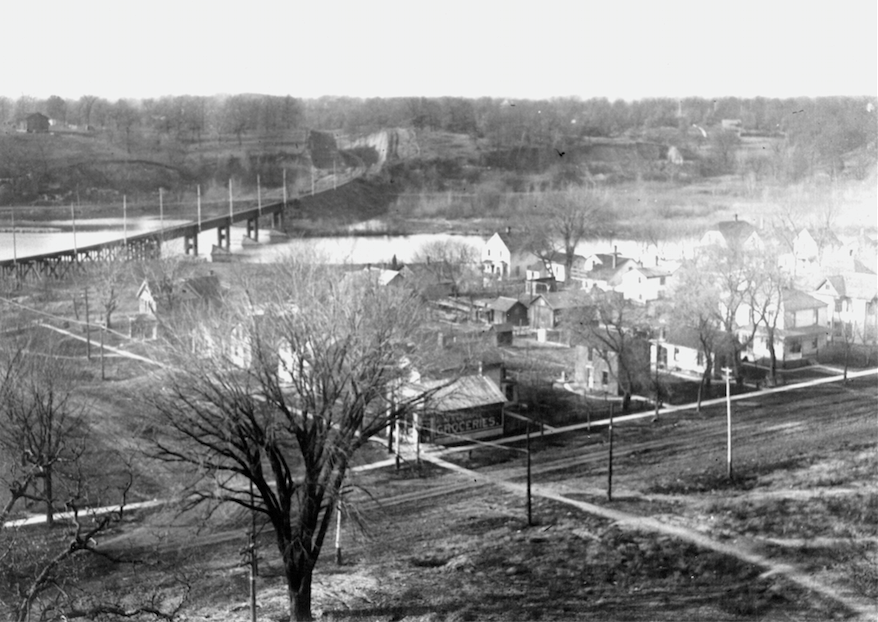 The Rinella Grocery Store was located on the neighborhood's corner in the foreground of this photograph. Image taken ca. 1911-15 on the hill in front of the Old Capitol facing west. Courtesy the State Historical Society of Iowa.