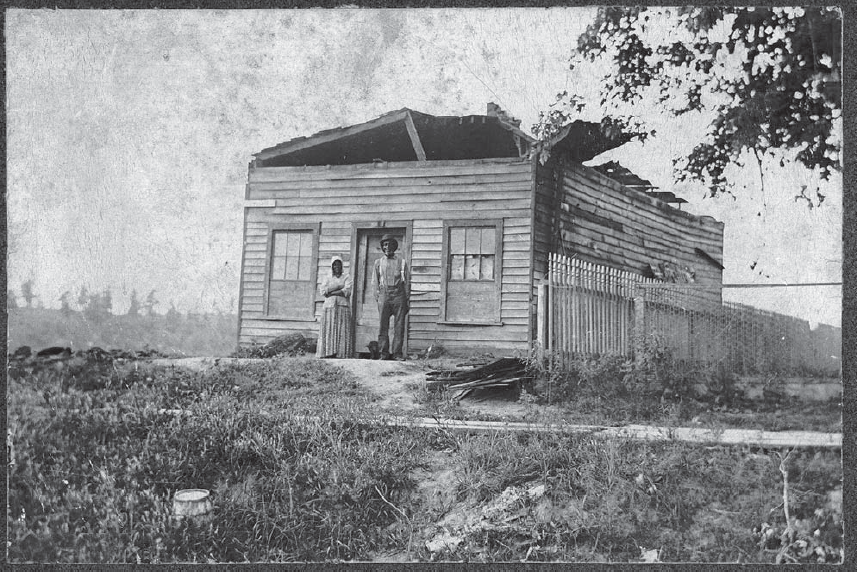 Bertha Horack's photograph of Paul and Rachel Ward standing outside of their home on Block 98. Image from the Office of the State Archaeologist.
