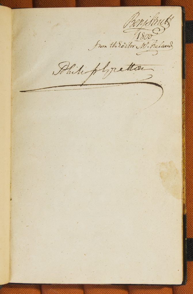 Open book with inscription