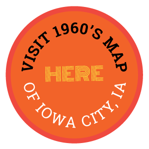 A circular button with the text, Visit 1960's map of Iowa City, Iowa